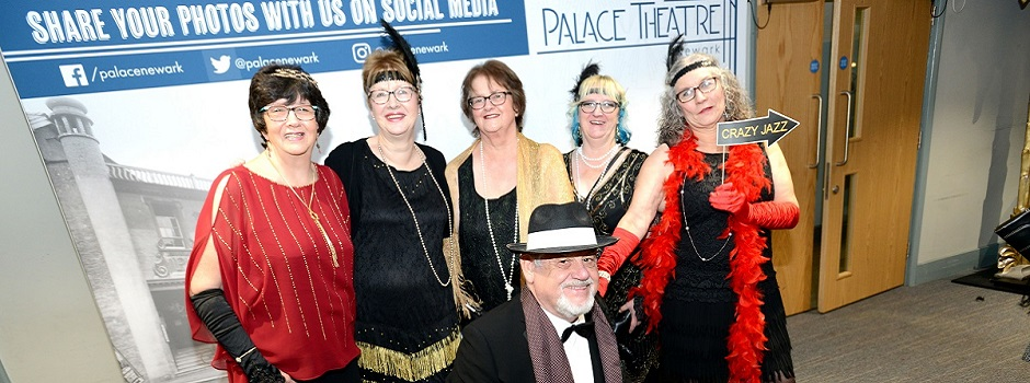 Palace Theatre volunteers wearing costumes from the 1920s era